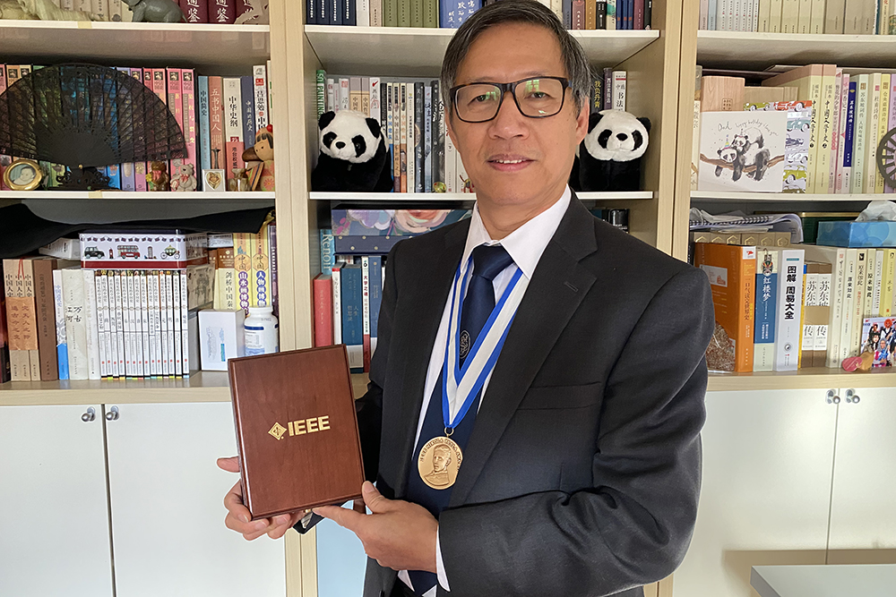 Image of Professor Zi-Qiang Zhu with the IEEE Nikola Tesla award