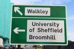 Road sign at university roundabout