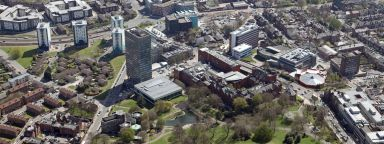 Aerial view of hexagonal Geography and Planning, green Weston Park and the Arts Tower