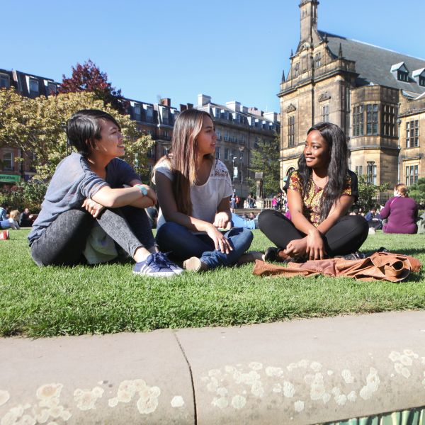 Students sitting in Peace Gardens by Town Hal