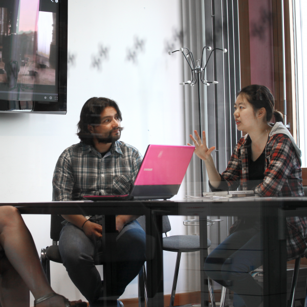 A group of postgraduate students in discussion