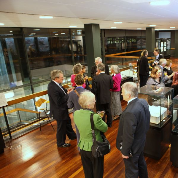 A group of alumni socialising in Western Bank Library