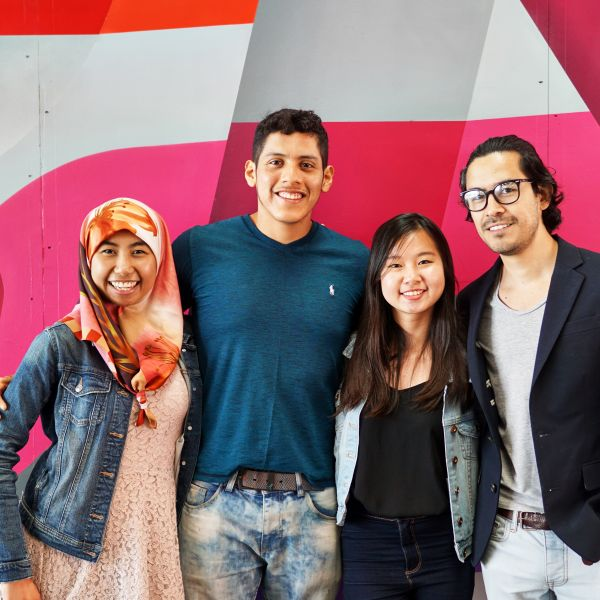 a group of students infront of a brightly coloured wall