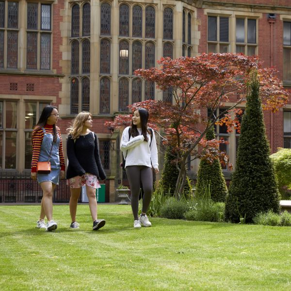 A group of students walking through Firth Court