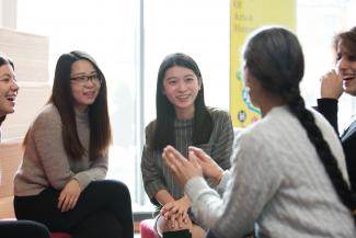 Image of discussion between postgraduate students in the department of languages and cultures