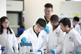 Group of Chemical and Biological Engineering postgraduates doing an experiment