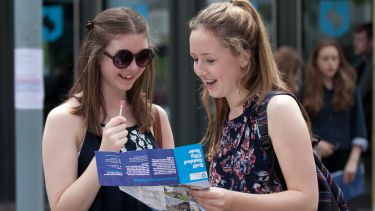Two visitors on an open day looking at the self-guided city tour