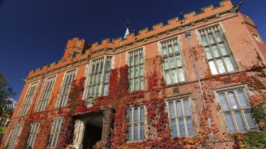Firth Court with ivy and blue sky
