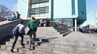 Information Commons - students walking on steps