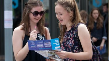 Students with map on open day