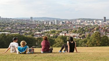 View of Sheffield skyline with students sitting