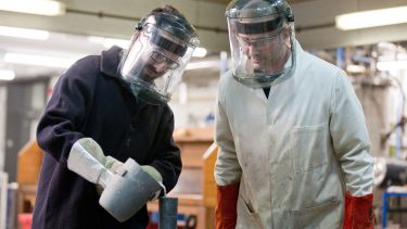 Image of two postgraduate materials science and engineering students with masks and equipment