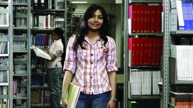 Postgraduate dentistry student in Library
