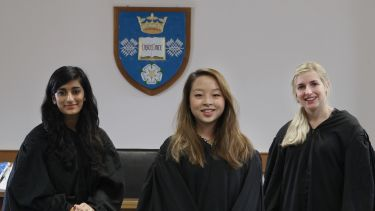 Three law students take part in mooting.
