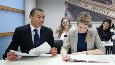 Law students dressed smartly and laughing in class