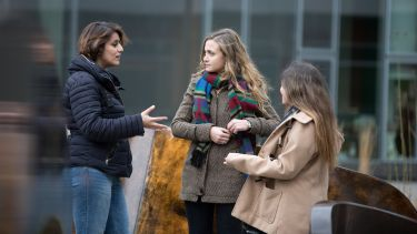 Three students chatting outside Jessop West