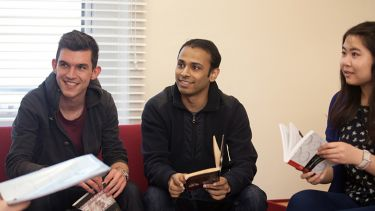 Postgraduate students participating in book discussion
