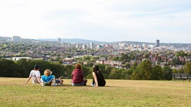 Students looking out over Sheffield from aerial view