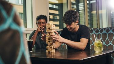 Students playing a game of Jenga