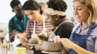 people doing pottery
