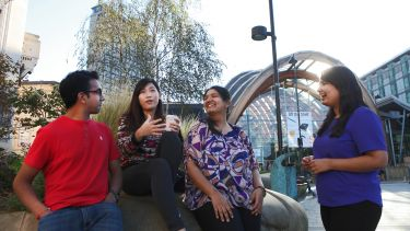 International students drink coffee at the Winter Gardens.