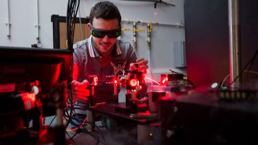 A Quantum Photonics student using lasers