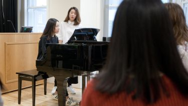 A postgraduate student playing the piano