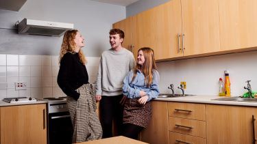 Endcliffe vale kitchen with students laughing