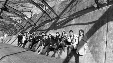 Digital architecture and design students sat on wall in Switzerland