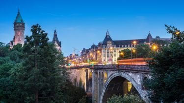 Adolphe bridge at twilight in Luxembourg City. Credit wichan yingyongsomsawas