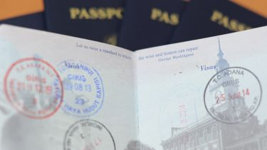 A passport with various visa stamps