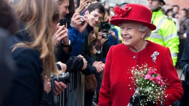 The Queen greeting people while on a visit to the University - image