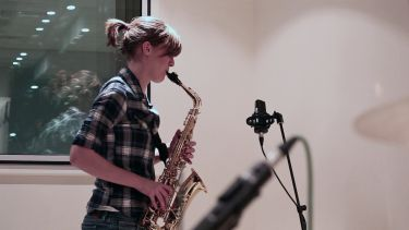 Saxophone player in studio