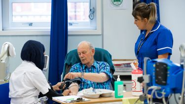 A patient as educator talking to a nursing student