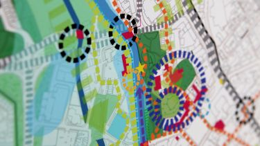A map showing road layouts, housing, and green spaces - image