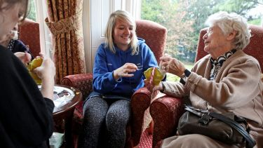 Student volunteering in a care home
