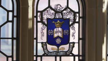 The University crest in stained glass