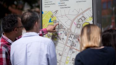 Visitors at an open day looking at a map