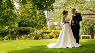 A couple getting married in the garden outside the Halifax Hall Hotel