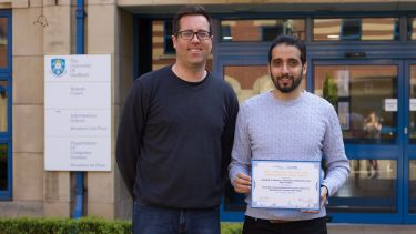 Prof. Phil McMinn and Ibrahim Althomali in front of Regent Court with their IEE paper award