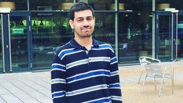 Aneeq ur Rehman. MSc Data Analytics Student. Standing outside the cafe at the student accommodation