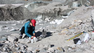 Student participating in fieldwork in glacial territory