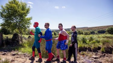 Community fundraisers undertaking The Big Walk dressed as superheros
