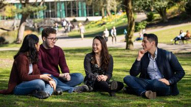 a group of students sat on the grass in Weston Park