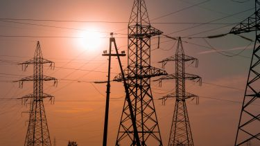 Energy pylons and a sunset - image