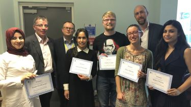 Winners of the postgraduate oral and poster presentations with their certificates.