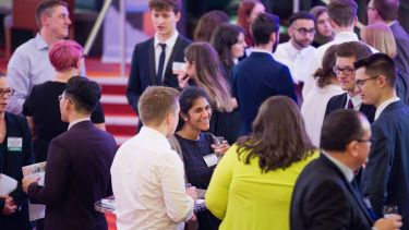 Students and alumni networking in the Crucible Theatre