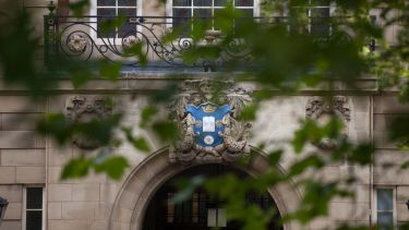 A shot of the university crest over the front door of the Sir Frederic Mappin building.