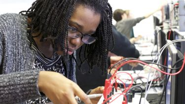 EEE student in the Electronics and Control lab in The Diamond