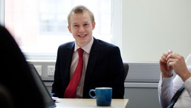 Photo of Richard Mosley Masters student working at the Department for Work and Pensions